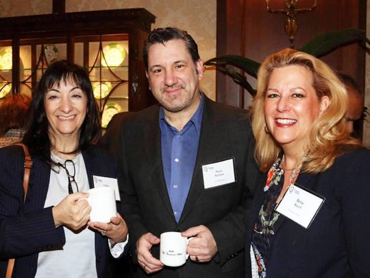 Libby Greenstone (from left), Birmingham Mayor Pro Tem Mark Nickita and Betsy Reich with The Colburn Group attending Tuesday's breakfast at the Townsend Hotel.