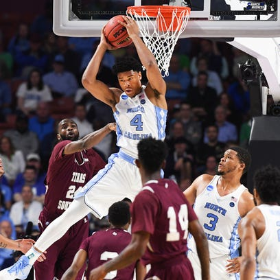 North Carolina forward Isaiah Hicks (4) gets a rebound