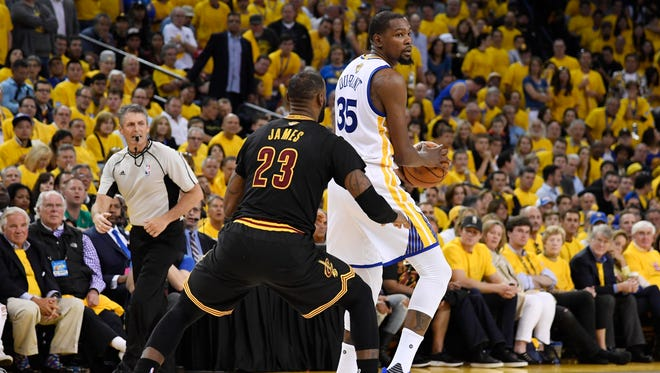 LeBron James defends Kevin Durant during the second half in Game 2 of the 2017 NBA Finals.