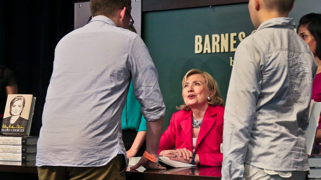 Hillary Clinton signs copies of her book at a Barnes & Noble bookstore in New York on Tuesday.