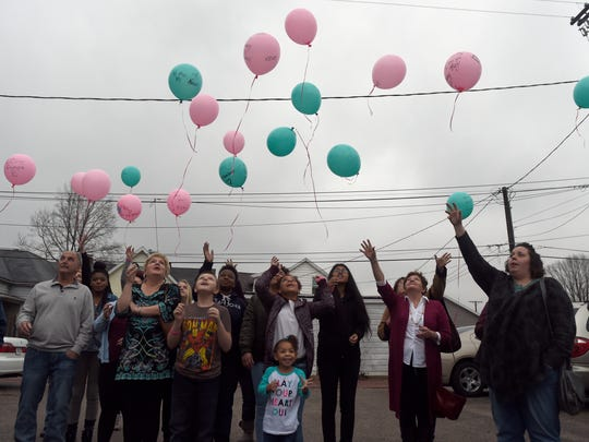 Friends and family members of Aleah Beckerle release balloons during a birthday party and service for the girl who turns 20 this week at St. Lucas United Church of Christ in Evansville Saturday.  About 50 people attended the event for Aleah who was reported missing July 17.