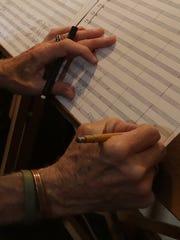 John Harmon works on a composition.