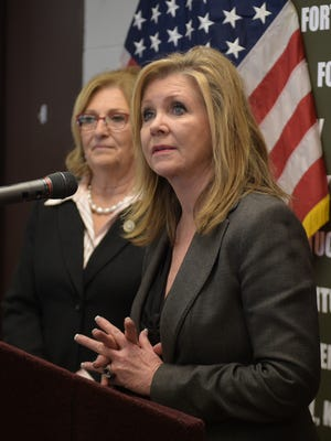 Rep. Marsha Blackburn, right, speaks as Rep. Diane Black looks on during a tour of Fort Campbell in Clarksville, Tenn., on Tuesday, March 7, 2017.