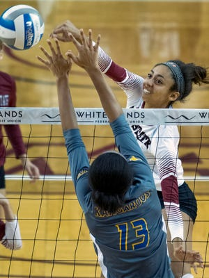 Aggies Brielle Sterns hits around the block of UMKC's Mykal Stadler Saturday afternoon at the Pan American Center.