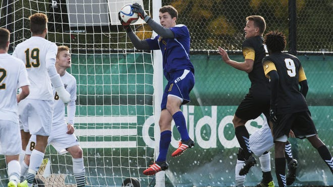 Vermont goalie Greg Walton (1) makes a save during the men's soccer game between the UMBC Retrievers and the Vermont Catamounts at Virtue Field earlier this season.