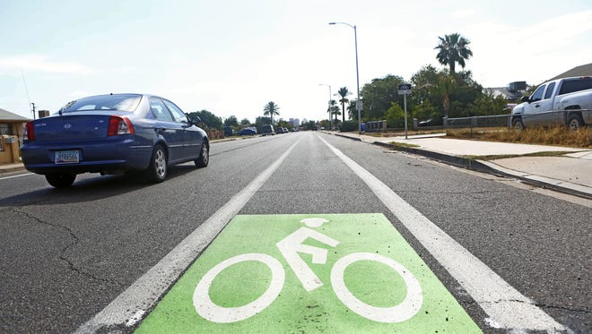 Signs mark the new bike lane on Jefferson Street in July 2017. In an effort to make downtown Phoenix more bike-friendly, bike lanes were installed on both Adams and Jefferson streets between 19th and 27th avenues.
