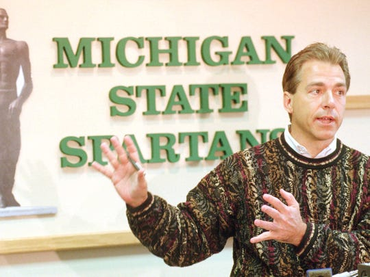 Michigan State University head football coach Nick Saban talks with reporters during a news conference in East Lansing on Jan. 1, 1998, where he denied any truth to a rumor about leaving the Spartans to coaching in the NFL.