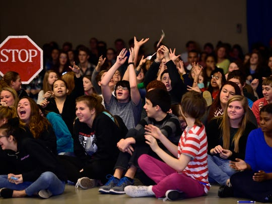 Students cheer and try to catch gifts thrown into the audience during the State Farm Celebrate My Drive presentation Wednesday, Dec. 23, 2015. Chambersburg Career Magnet School won $100,000 in the contest.