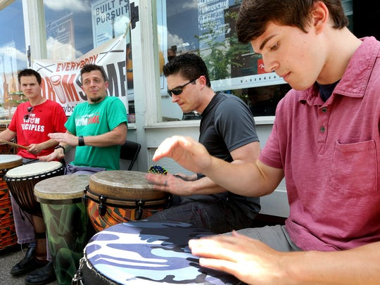 From left, Nick Myhre, Ross Lester and Ben Goins all drum on the sidewalk along West Main Street. Lester will be leading a drum circle as part of Make Music Day, set for 7 p.m. June 21 at Old Fort Park.