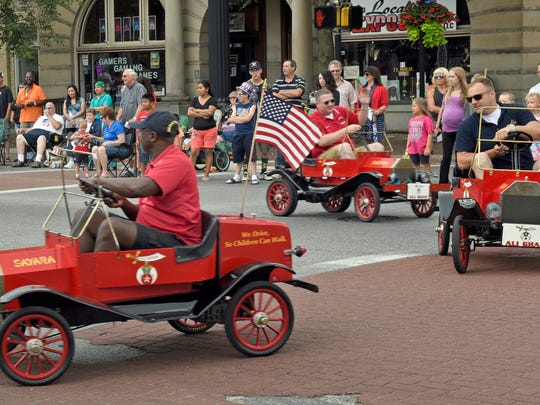 Franklin County Shriners entertain the parade crowd. Waynesboro's Brothers of the Brush 4th of July parade was held along Main Street on Monday, July 4, 2016.