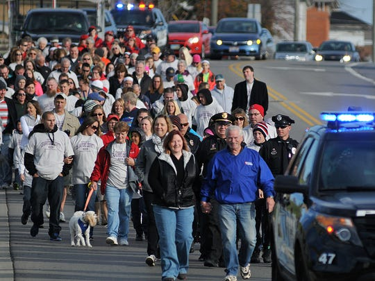 Marchers head south down Sandusky Avenue during a previous Community Care March in Bucyrus. This year's march will take place Nov. 2.
