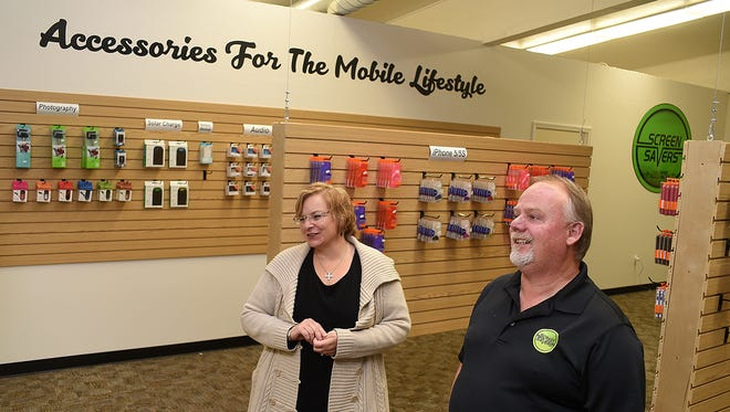 Owners Joan Fauteaux, left, and Mike Fauteaux talk about their new business Screensavers Inc. on Thursday at 4339 E. Main St. in Farmington.