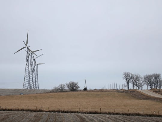 Wind turbines spin in the breeze on Feb. 23, 2017,