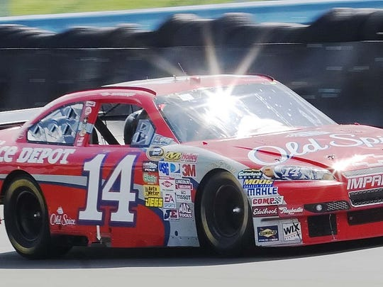 Tony Stewart comes out of Turn 11 leading the Heluva Good Sour Cream Dips at The Glen in 2009.