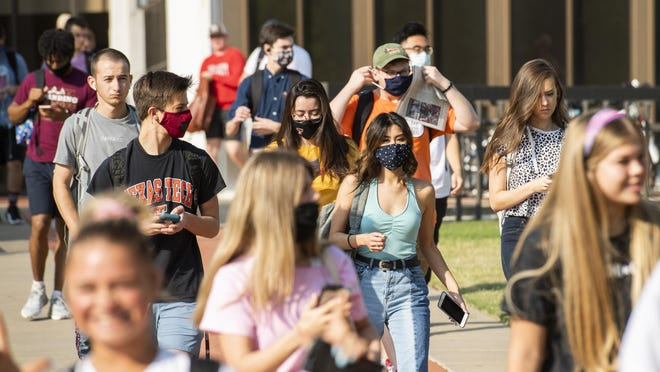 Students leave the College of Media and Communications on the Texas Tech University campus on the first day of the Fall 2020 semester on Monday, Aug. 24, 2020, in Lubbock, Texas.
