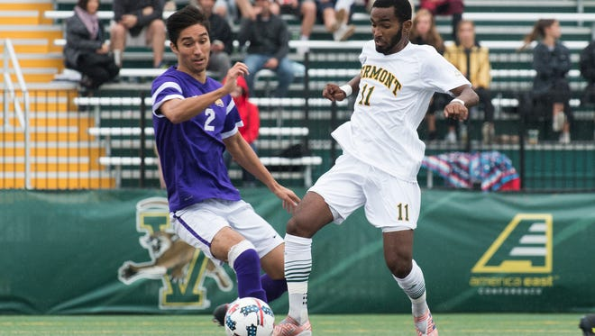 Vermont's Geo Alves (11) battles for the ball with Albany's Kaz Boschen (2) during the men's soccer game between the Albany Great Danes and the Vermont Catamounts at Virtue Field on Saturday afternoon October 7, 2017 in Burlington.