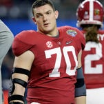 Alabama offensive lineman Ryan Kelly (70) warms up before the Cotton Bowl NCAA college football semifinal playoff game against Michigan State, Thursday, Dec. 31, 2015, in Arlington, Texas.