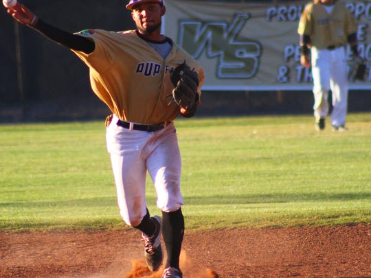 White Sands shortstop Brandon Torres makes a throw