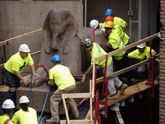Workers move a 25,000-pound Sphinx of Ramses II Wednesday at the Penn Museum in Philadelphia. The 3,000-year-old sphinx is being relocated from the Egypt Gallery, where it's resided since 1926, to a featured location in the museum's new entrance hall.