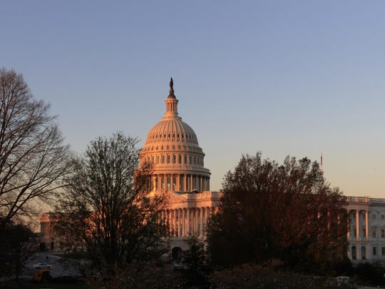 FILE - In this April 5, 2017, file photo, the Capitol is seen at sunrise in Washington. At a time when many Americans say they're struggling to distinguish between fact and fiction, the country is broadly skeptical that facts underly some of the basic mechanisms of democracy in the United States - from political campaigns to voting choices to the policy decisions made by elected officials. (AP Photo/J. Scott Applewhite)