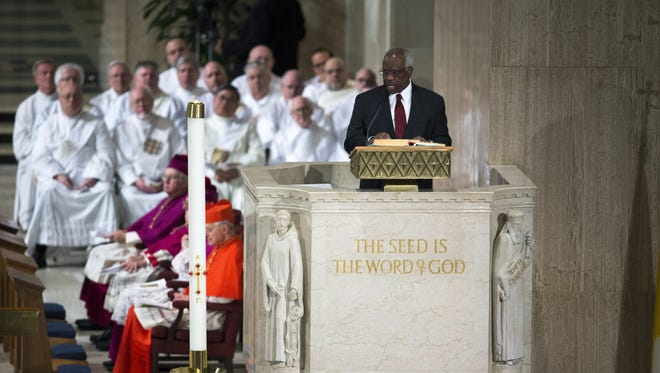 Justice Clarence Thomas delivers a reading during the funeral Mass for Associate Justice Antonin Scalia at the Basilica of the National Shrine of the Immaculate Conception Saturday. Scalia, who died February 13 while on a hunting trip in Texas, layed in repose in the Great Hall of the Supreme Court on Friday and his funeral service will be at the basilica today.