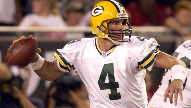 It was a tough call, but Mike Vandermause gave Brett Favre the edge over Aaron Rodgers at the quarterback position.