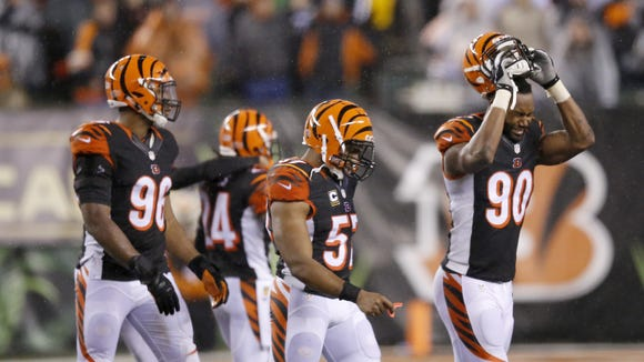 Frustrated Bengals defenders leave the field after a costly penalty in the fourth quarter of Saturday's loss to the Steelers.