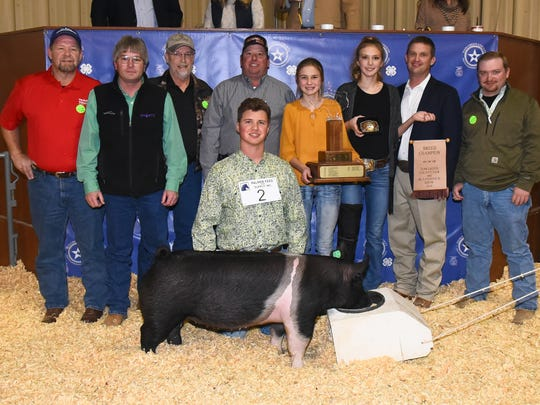 Tate Jones representing Wall FFA earned grand champion hog during the 2018 Tom Green Junior Livestock Show on Jan. 12-13. Buyers: 1st Community Federal Credit Union, Vicki Loso; Twin Mountain Fence, Raymond Meza; Texas Trust Credit Union, Brett Nikolauk; Top Tier Grain Co.; PAK Quality Foods; Helena Chemical; Workhouse Wealth, Michael Jones.