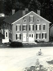 The Mason House Inn is pictured in 1982. Previous co-owner Herbert Redhead is shown in front of the inn with his bicycle. Redhead and his wife, Buretta, bought the historic hotel from the Mason family in the 1950s.