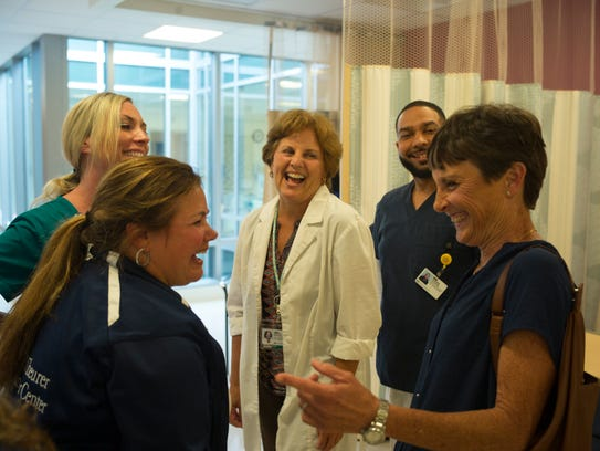 Kathy Graef laughs with the staff at the John Theurer