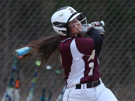 Arlington's Liz Tolkan (7) at bat against Clarkstown North during softball action at Arlington High School April 17, 2018. Arlington won the game 22-21.