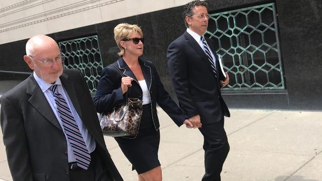 Alphons Iacobelli, far right, leaves the U.S. District Court in Detroit on August 1, alongside Susanne Piwinski-Iacobelli and his lawyer David DuMouchel, left.