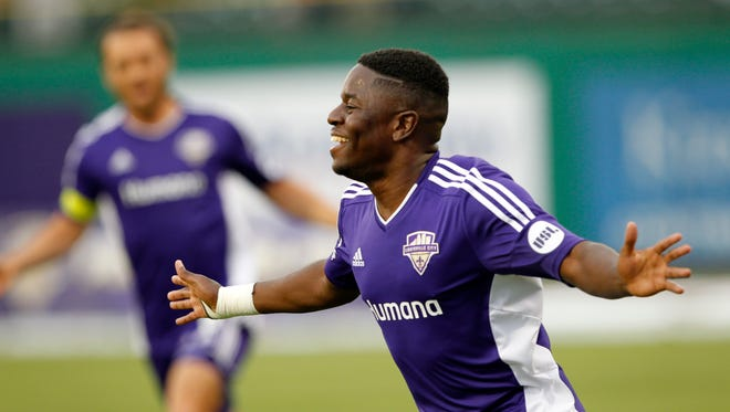 Louisville FC's Kadeem Dacres (7) celebrates after scoring against Toronto FC during their game at Louisville Slugger Field in Louisville, Kentucky.         May 16, 2015