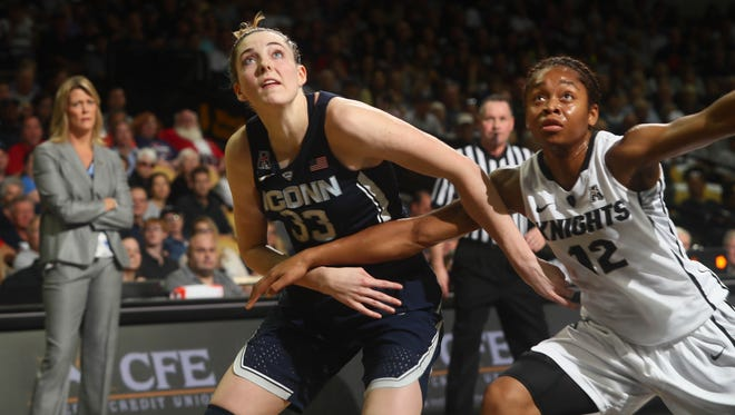 Connecticut's Katie Lou Samuelson (33) and UCF guard Nyala Shuler (12) battle for a rebound.