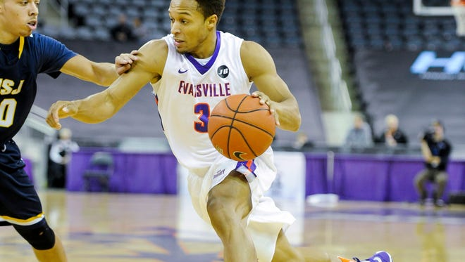 University of Evansville guard Jaylon Brown (3) drives past Mount St. Joseph guard Andrew Finley (20) during their game at the Ford Center in Evansville, Thursday, Dec. 22, 2016. The University of Evansville beat Mount St. Joseph 68-55.