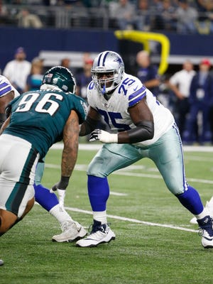 Offensive tackle Byron Bell (75) prepares to block against the Philadelphia Eagles defensive end Derek Barnett (96) during a Nov. 19, 2017, game in Arlington, Texas.