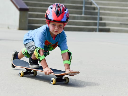 Second generation skateboarder Brayden Steenblock, 3, has fun riding on Saturday, August 6, 2016, during the Skateboard Xtreme Challenge at Urbandale Skate Park.