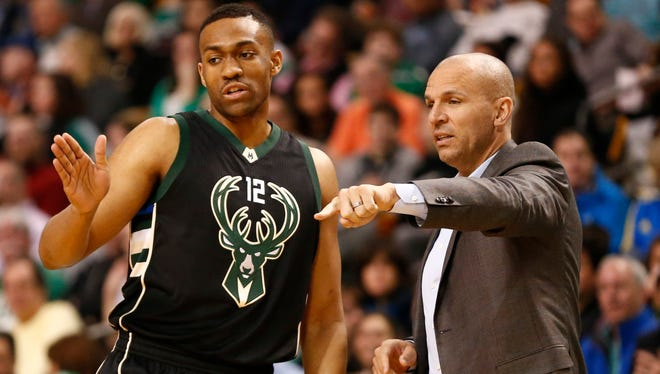 Milwaukee Bucks head coach Jason Kidd speaks to forward Jabari Parker during the first half of a game against the Boston Celtics at TD Garden. The Bucks finalized a three-year contract extension on Tuesday to keep Kidd as head coach through 2020.
