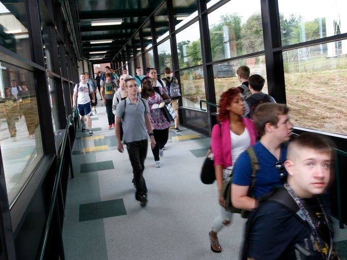 Northwest High school students walk in the security, element free hallway Monday, between the main building and the 400 building, which opened at the beginning of school last week.