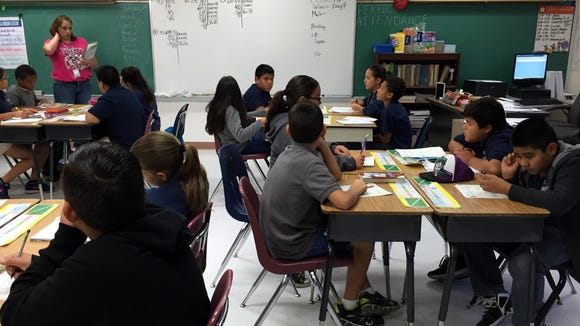 Students in a fifth-grade class at Jose H. Damian Elementary School begin the day with math on Oct. 15.
