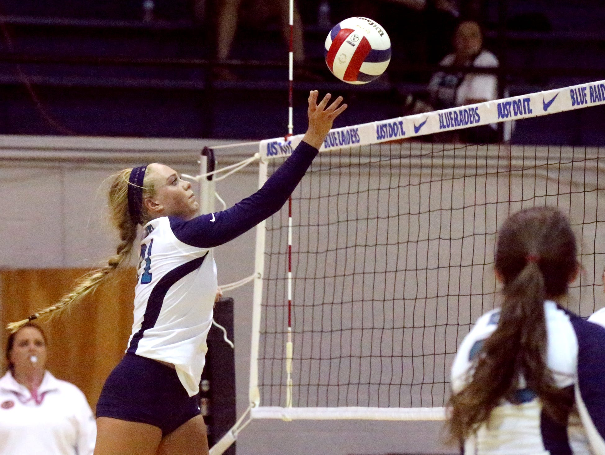 Siegel's Leah Poarch (21) hits the ball over the net during the second round of the TSSAA Class AAA state volleyball tournament against Bearden Wednesday at MTSU.