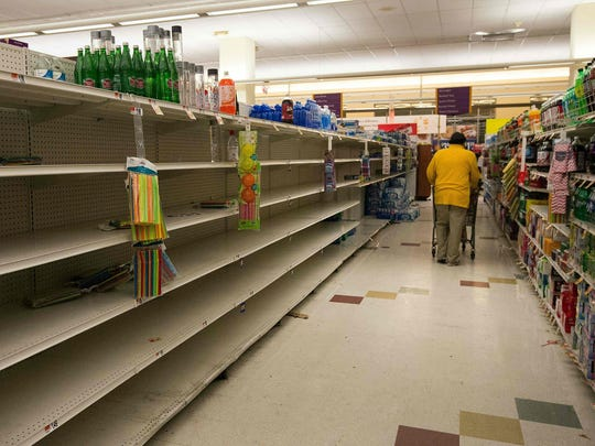 Nearly empty shelves are seen in a supermarket in Washington, D.C., Friday.