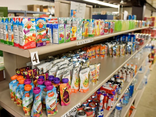 Shelves are filled with food Thursday, June 16, 2016 at Maranatha Food Pantry, Chambersburg.