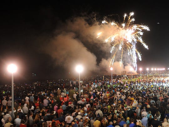 Crowds on Sunday view the Rehoboth Beach fireworks, one of numerous Independence Day weekend activities across Delaware.
