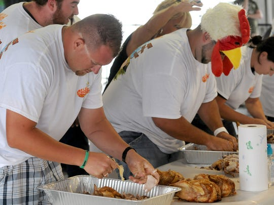 Contestants compete in the the annual chicken pickin' contest at the Delaware State Fair, which starts July 21.