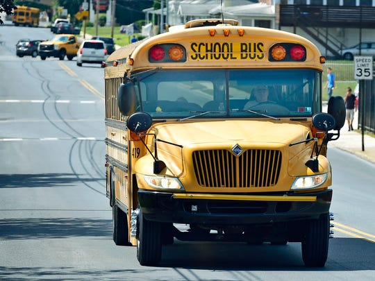 A school bus travels along McKinley Street, Chambersburg during the first day of School on Thursday, August 18, 2016. Superintendent Joe Padasak this week suggested several cost-saving measures, including requiring students in first through 12th grades who live close to school to walk or use their own transportation. This would affect 658 students and eliminate one bus route, saving the district $102,000 annually, according to Padasak's report.