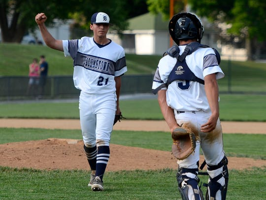 Dallastown pitcher Nick Parker reacts after winning