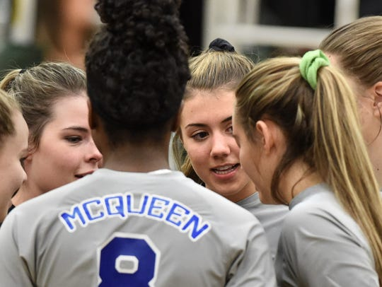 McQueen's Kaila Spevak, right, huddles with teammates
