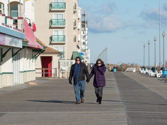 Lloyd and Nancy Webb of Milford walk on the boardwalk in Rehoboth Beach on New Year's Day.