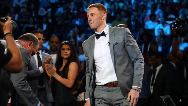 NEW YORK, NY - JUNE 21:  Donte DiVincenzo reacts after being drafted 17th overall by the Milwaukee Bucks during the 2018 NBA Draft at the Barclays Center on June 21, 2018 in the Brooklyn borough of New York City. NOTE TO USER: User expressly acknowledges and agrees that, by downloading and or using this photograph, User is consenting to the terms and conditions of the Getty Images License Agreement.  (Photo by Mike Lawrie/Getty Images)